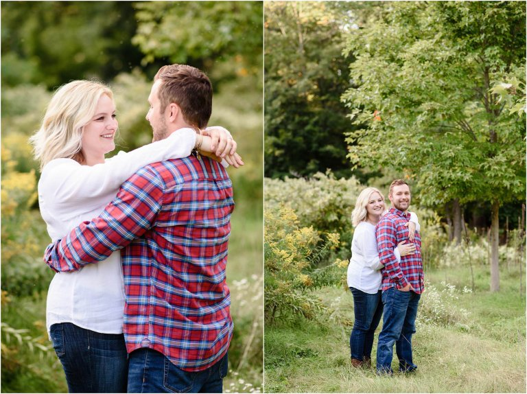 couple standing for engagement session at hillside farms