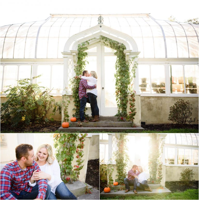 Engaged couple poses in front of greenhouse for session with Crystal Satriano at hillside farms.