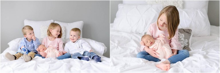 Scranton Newborn Photographer Crystal Satriano shows all four siblings laughing together on a bed