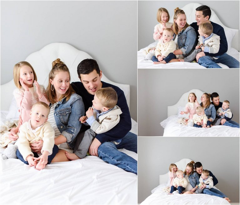 family snuggled on bed in photography studio moscow pa