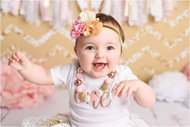 Girl first birthday photos in gold and pink theme by Moscow PA photographer Crystal Satriano