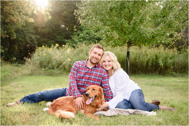 Couple poses with their golden retrieve at Hillside Farms.