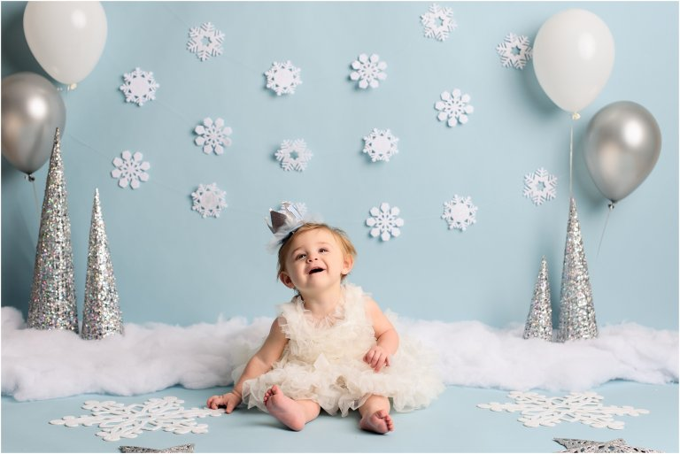Pittston baby photographer baby in white dress smiling photo by Crystal Satriano Photography