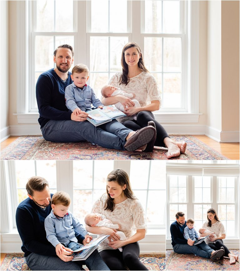 Family posing with a newborn in front of a window.