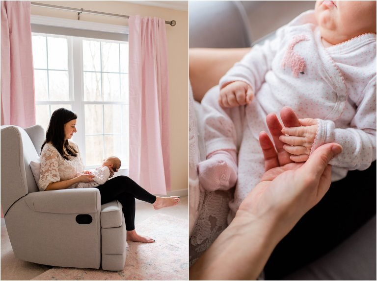 Close up of mother holding newborn baby girl's hand while sitting in a chair in front of window.