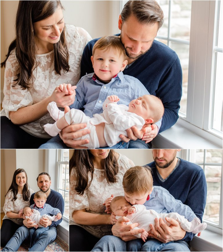 Family posing with a newborn in front of a window during an in-home lifestyle newborn session.
