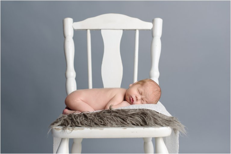 Dickson City photo studio newborn sleeping on chair photo by Crystal Satriano Photography