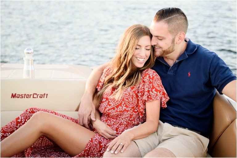 Harvey's Lake engagement session photographed by Crystal Satriano together on a boat out on the lake.