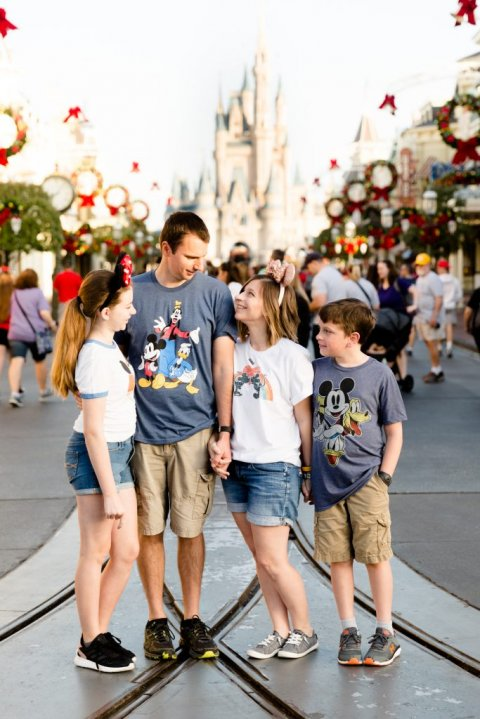 family photo in front of castle at Disney World