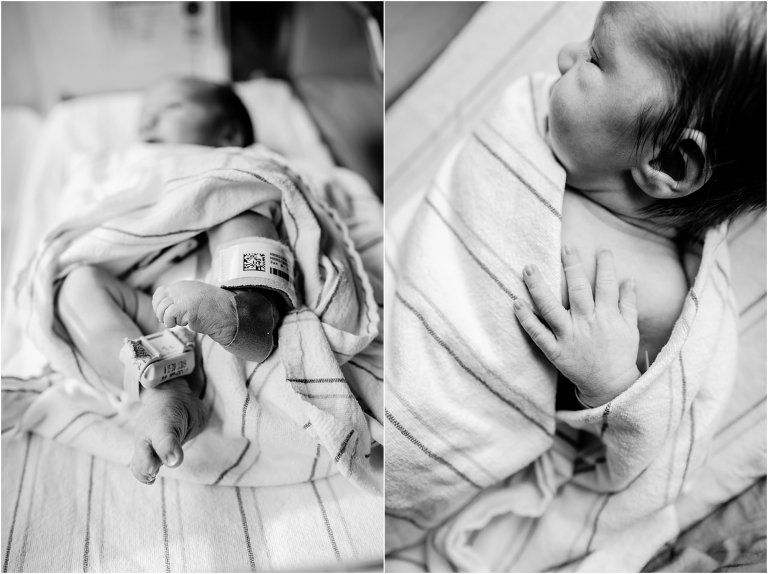 Feet and hand of newborn baby in the hospital.
