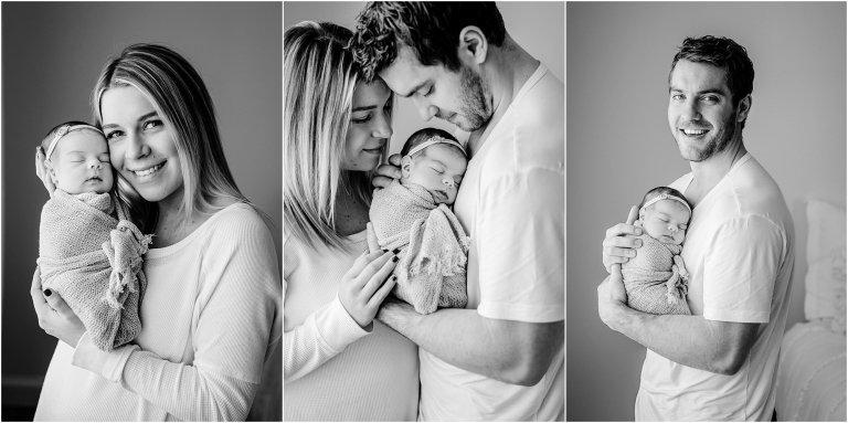Parents hold newborn in in a Scranton newborn photography studio.